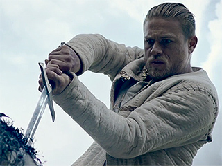 FROM EW: Charlie Hunnam Goes Medieval in King Arthur Trailer
