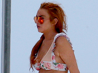 Lindsay Lohan Steps Out in a Bikini and Is Seen Smoking Amid Pregnancy Claims