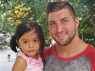 Go Behind the Scenes of Tim Tebow's Mission Trip to the Philippines