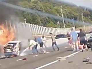 WATCH: Fellow Motorists Rescue Elderly Woman from Burning Car in Amazing Dash Cam Footage