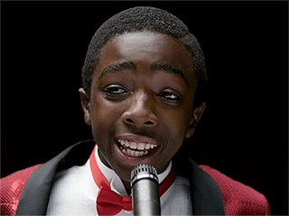 WATCH: Stranger Things' Caleb McLaughlin Shines (and Croons) in The New Edition Story