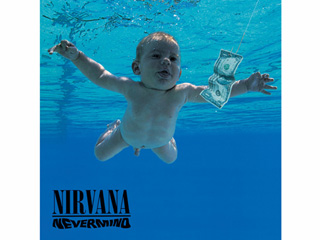FROM EW: Nirvana Baby Recreates Nevermind Album Cover 25 Years Later