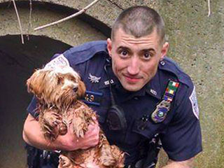 PHOTO: Police Officer Climbs In Tunnel Barefoot to Rescue Frightened Pooch