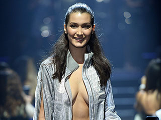 Bella Hadid Wears the Most Cleavage-Baring Disco Jacket Ever for amfAR Cannes Fashion Show