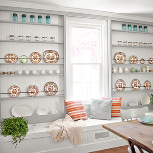 dining room with built-in display shelves after