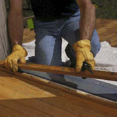Prepare the sill by removing the adjustable wood strip from the original threshold