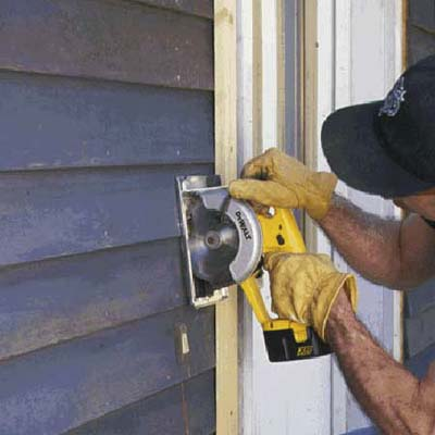 Run a circular saw along the guide, cutting only through the siding