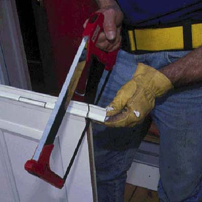 Cut the flange with a hacksaw to match the height of the door opening