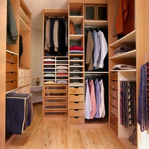 modern dressing room with closet system and parquet floor
