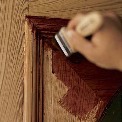 Choose a finish and apply first coat how to refinish a - Como pintar una puerta de madera con brocha ...
