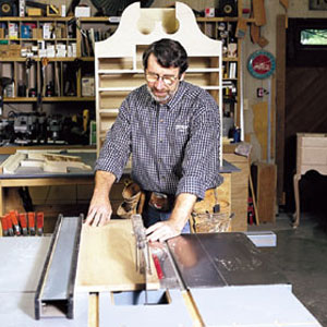 Norm Abram ripping a wide board with a table saw