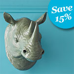 grey faux taxidermy rhino head hanging from a blue wall with text in the upper corner that says 15 percent off