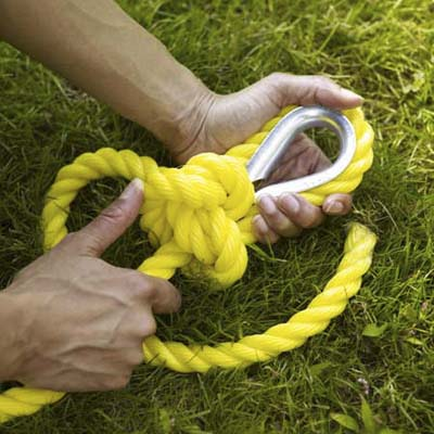 tying a secure knot to attach the rope that will hold up the swing