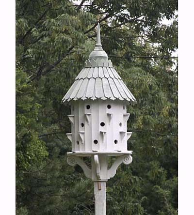 castle-like purple martin birdhouse with scrolled bracket and tapered shingles
