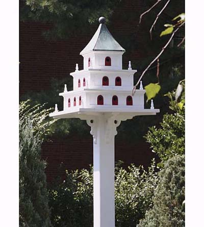 purple marlin birdhouse with scrollwork, patinated copper roof, and 24 doors