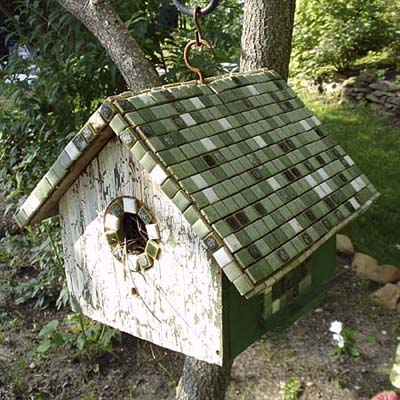 tile-roofed birdhouse hung from tree