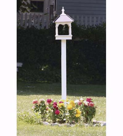 bandstand-style bird feeder with flower bed at base
