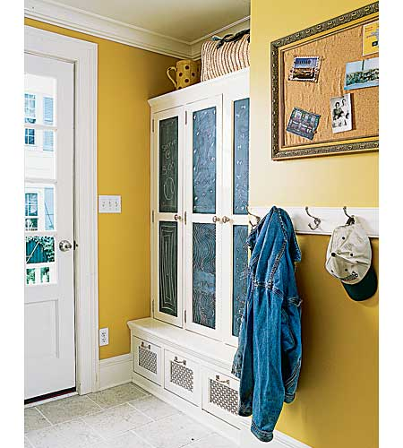 mudroom with shelves, hooks, and a message board