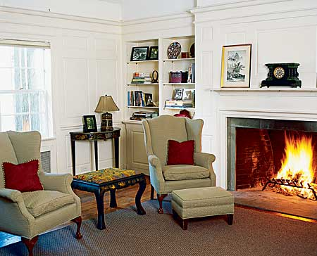 living room with built-in shelves and fireplace