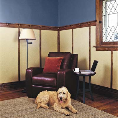 reading nook  has new wainscoting and paint colors. Rich blue on top and soft yellow-gold in the bottom