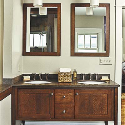 furniture-like wood vanity in master bathrooom