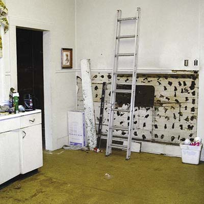 before image of remodeled kitchen with ladder