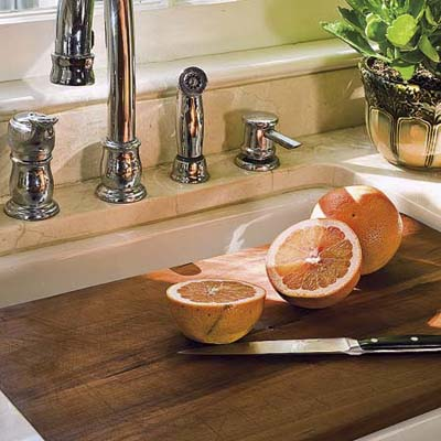 cherry wood cutting board in a remodeled 1850s cottage kitchen