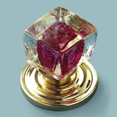 glass doorknob in clear cube with raspberry colored center