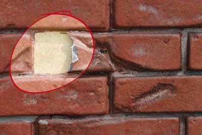 Damaged fake plastic brick