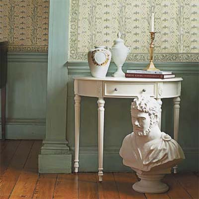 urns, desk, bust, candlesticks, and wallpaper that evoke the Federal style