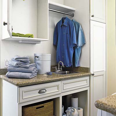 laundry room/mud room with cabinets