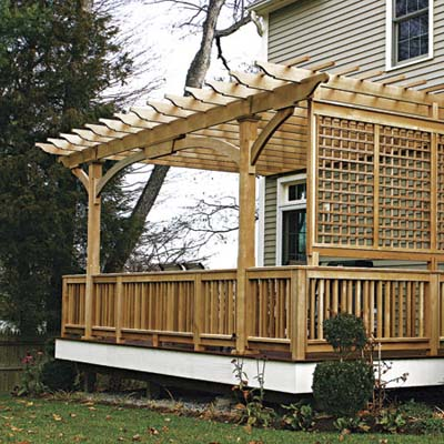 wooden deck with open walls and trellis