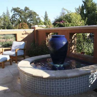 open deck patio with a small decorative fountain