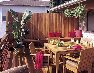 A deck with redwood staves for a privacy wall