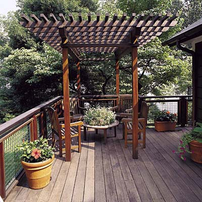 pergola on deck with wire-mesh railing