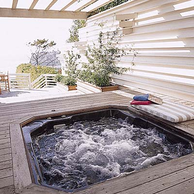 deck with a hot tub