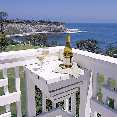 ocean view, wine bottle on corner table