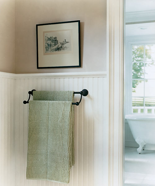 a light color scheme on wainscoting and walls