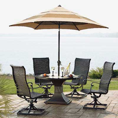 swivel patio chairs with marble-topped table and umbrella