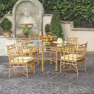 faux bamboo aluminum patio set with cushions and glass-top table