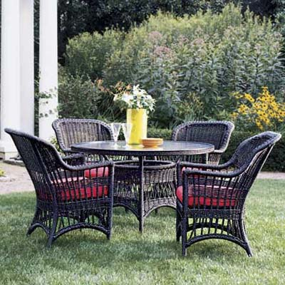 synthetic wicker patio set with glass-topped table