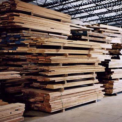 cherry wood boards piled up in Thos. Moser shop