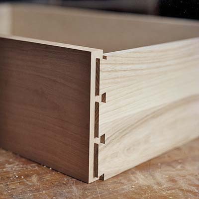 partially constructed heirloom dresser drawer showing dovetail joints