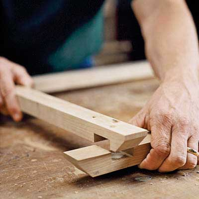 gluing half-lap joints where the rails intersect to support the top of the dresser