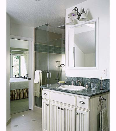 His vanity next to shower in shared bathroom