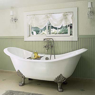 Bathtub under window in shared bathroom