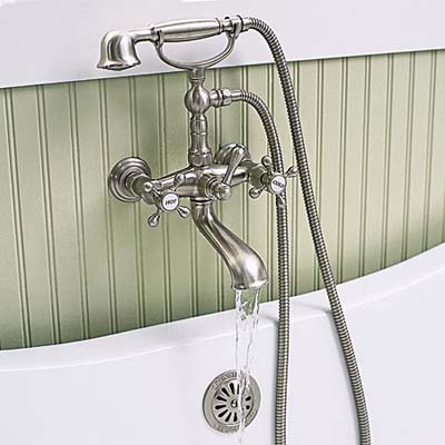 Brushed nickel tub filler in shared bathroom