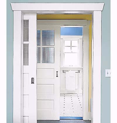 Sliding doors between master bedroom and shared bathroom