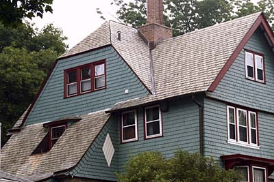 green exterior paint with white and red trimming