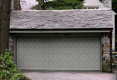 garage doors painted a mossy green